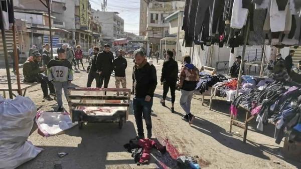 21일 이라크 바그다드 상업지역 연쇄 자살 폭탄 테러 현장. ⓒAP/뉴시스