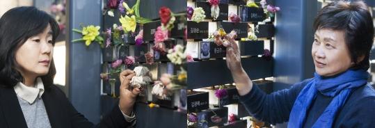 정의기억재단 지은희 이사장과 윤미향 상임이사가 16일 서울 마포구 전쟁과여성인권박물관 내 마련된 일본군'위안부'피해자 추모관에서 돌아가신 할머니들의 사진을 보고 있다. ⓒ이정실 사진기자