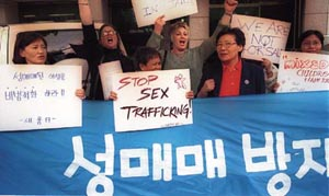 Demonstration at Myongdong Cathedral on October 11 staged by the participants of the International Symposium to Counter Prostitution and Human Trafficking. Demonstrators called for the enactment of special laws to prevent prostitution.