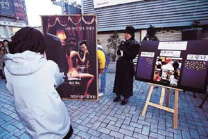 Moviegoers participating in a publicity event for . People seem to accept violent, macho fantasies without any qualms.