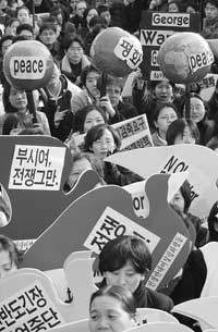 Civic groups national rally against Bushs visit to Korea held in Jongmyo Park on February 20. Lee Kim Hyun Sook, senior representative of Women Making Peace was injured due to excessive police suppression.