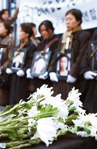Women dancers take part in the Feminist Funeral held in Gunsan at the scene of the fire, comforting the souls of the deceased.