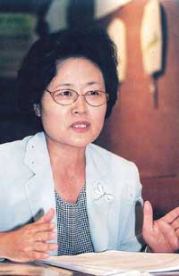 Lee Kim Hyun Sook / Senior Representative of the Womens Peace Society and Chair of the Womens Committee under the Preparatory Committee for the 2002 Joint National Celebrations