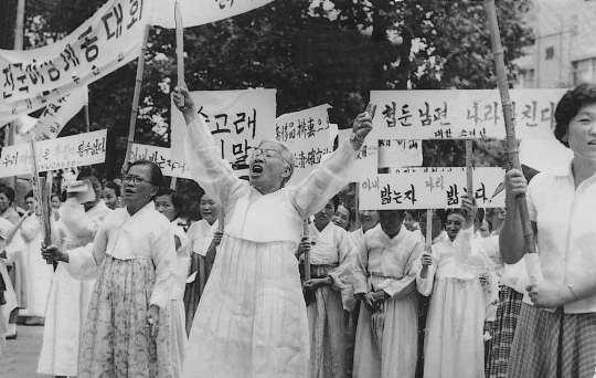 "Knowing how many National Assembly members kept concubines, YWCA marched around the streets of Myeong-dong in 1960 to protest against such politicians joining the National Assembly."" It was a big rally with over 2,000 women in white Hanbok.   ⓒ Korea YWCA"