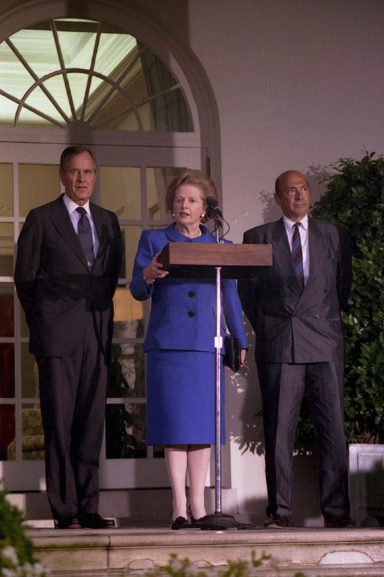 June, 1990, former British prime minister Margaret Thatcher is answering journalists' questions at the US White House. Next to Thatcher is former US president George Bush (left) and former North Atlantic Treaty Organization (NATO) secretary general Manfred Werner. ⓒ US White House Bush Library