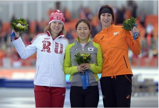 Lee Sanghwa on the podium with silver medallist Olga Fatkulina of Russia(left) and bronze medallist Margot Boer of the Netherlands(right)