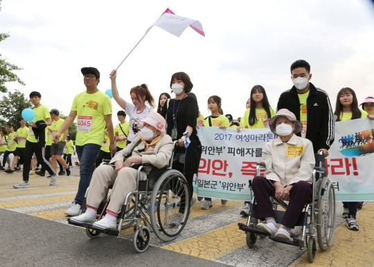 "Oksun Lee and Oksun Park, the surviving ""comfort women"" from South Korea participated in 4 km walkathon with House of Sharing employees and 40 volunteers at World Cup Park in Seoul, on May 13."